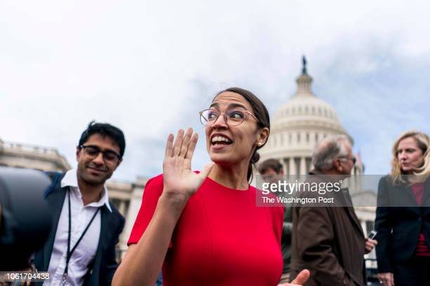 WASHINGTON DC On the US Capitol east front plaza 116th Congressional freshman Representatives like Alexandria OcasioCortez rush off after the...