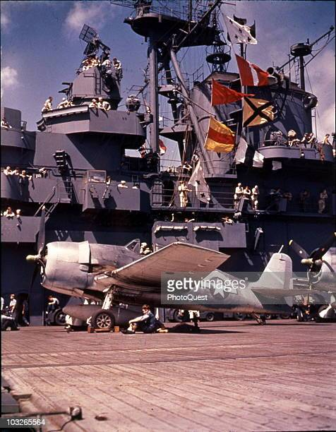 On the US Navy aircraft carrier the USS Yorktown a Grumman F6F3 Hellcat fighter sits on the flight deck during Pacific operations 1943