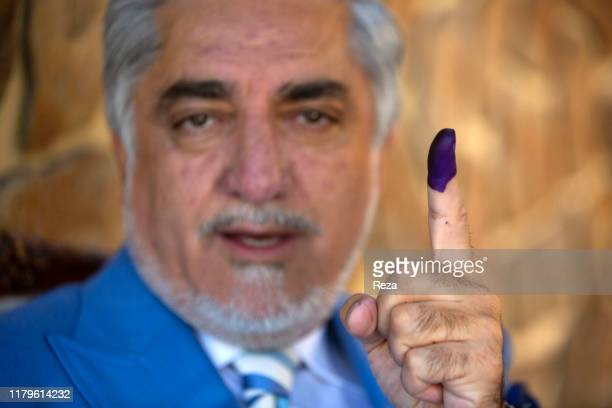 On the voting day, portrait of the candidate Dr Abdullah his finger is inked in blue to prove he voted. Dr Abdullah Abdullah is an Afghan political...
