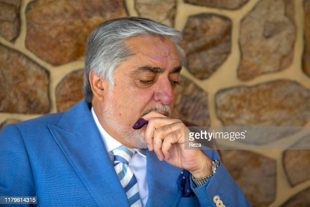 On the voting day, portrait of the candidate Dr Abdullah his finger is inked in blue to prove he voted.Dr Abdullah Abdullah is an Afghan political...