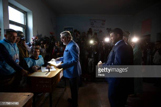 On the voting day, the candidate Dr Abdullah conducts his civil duty by voting under the watch of those present. Dr Abdullah Abdullah is an Afghan...