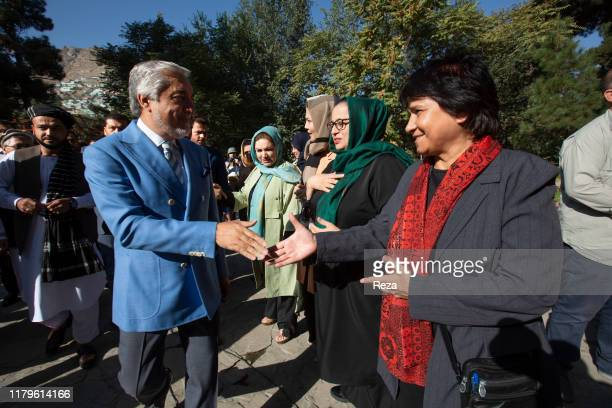 On the voting day, the candidate Dr Abdullah shakes the hand of Shulira Heydar, an afghan women activist whom counselled him during his campaign. The...