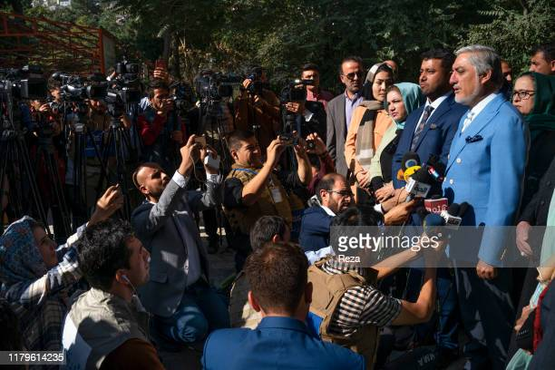 On the voting day, the candidate Dr Abdullah speaks after voting under the watched of those present. He answers to journalists' questions.Dr Abdullah...