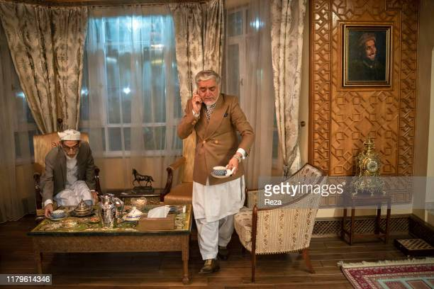 On the voting day, the candidate Dr Abdullah takes a phone call. Dr Abdullah Abdullah is an Afghan political leader, Chief Executive Officer of the...