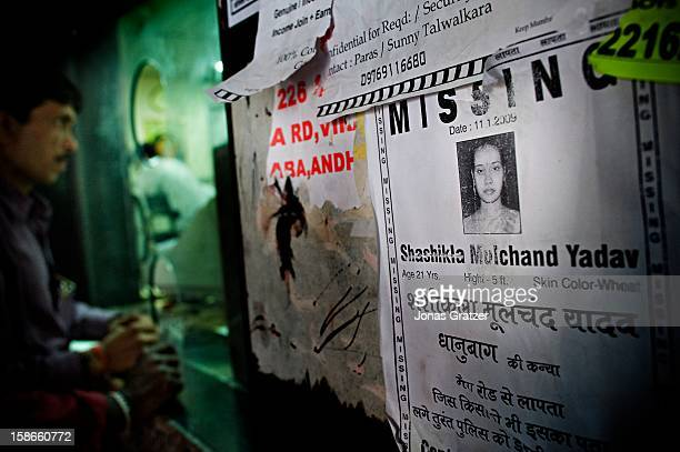 On the wall at the train station in Mumbai signs for missing girls and women are posted New sexslave trade routes have opened up taking girls who...