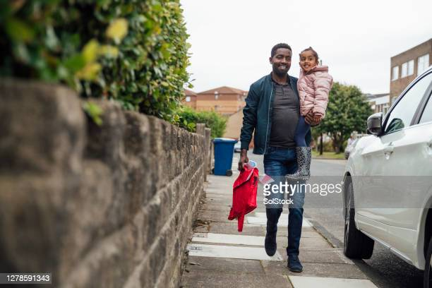 on the way back from nursery - walking stock pictures, royalty-free photos & images