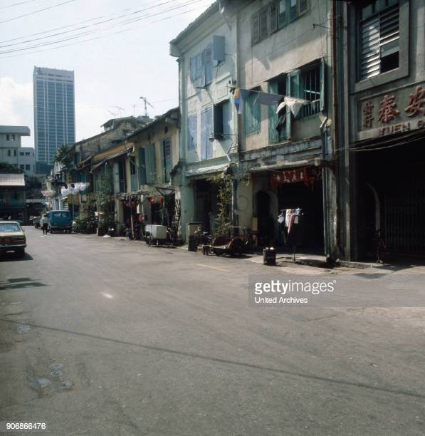 On the way in the streets of Chinatown in Singapore 1980s