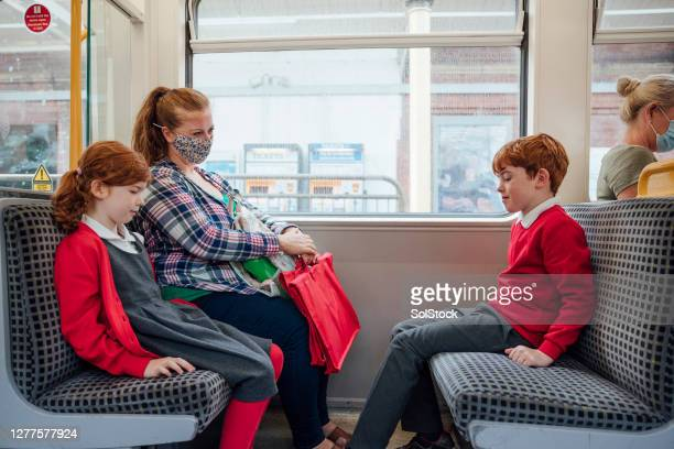 on the way to school! - train interior stock pictures, royalty-free photos & images