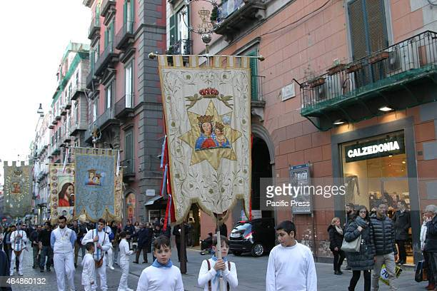 On the weeks that anticipate the religious rites of Holy Easter the devotees of Madonna dell'Arco marches through the streets of the city in...