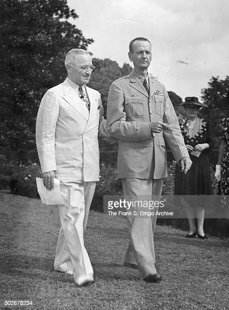 On the White House grounds American politician and US President Harry S Truman escorts General Jonathan M Wainwright during a ceremony to award the...