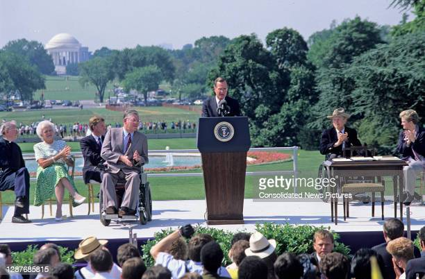 On the White House's South Lawn, US President George HW Bush speaks prior to the signing ceremony of the Americans with Disabilities Act of 1990 ,...