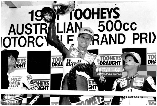 On The Winners PodiumWayne Rainey salutes crowd as Mike Doohan amp John Kocinski April 7 1991