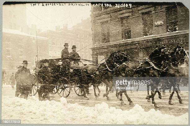 On their way to his inaguration, incoming US President William Howard Taft and outgoing US President Theodore Roosevelt ride in a carriage along the...