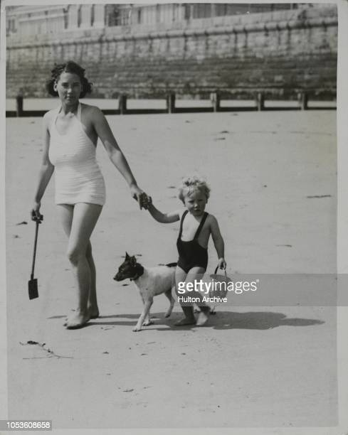 On Their Way To The Sea, Early holidaymakers take advantage of the fine spell of weather and keep cool in bathing costumes and sunbathe on the beach...