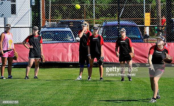 On Thursday July 18 2013 Michaela Patteresson throws the ball to home after catching a pop fly during an outfield drill as a team of Swedish softball...