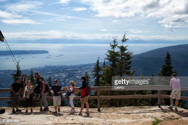 on top of grouse mountain, north vancouver, canada - grouse mountain stock photos and pictures