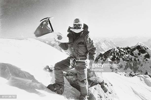 Climber Naoe Sakashita of Japan waves flags of Japan and China as he reaches the summit of K2 the world's second highest mountain August 14th The...