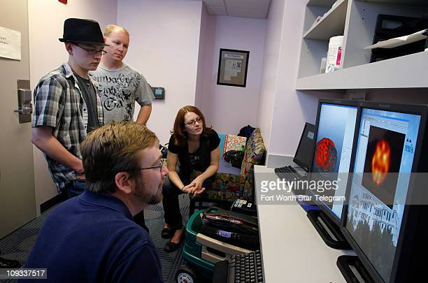 On Tuesday February 15 Michael Driggars left and his father Kevin mother Brandy listen as Joe Paugh bottom a neurosciences software bioengineer...
