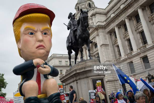 On US President Donald Trump's second day of a controversial three-day state visit to the UK, a Trump effigy tweets while sitting on a golden toilet...