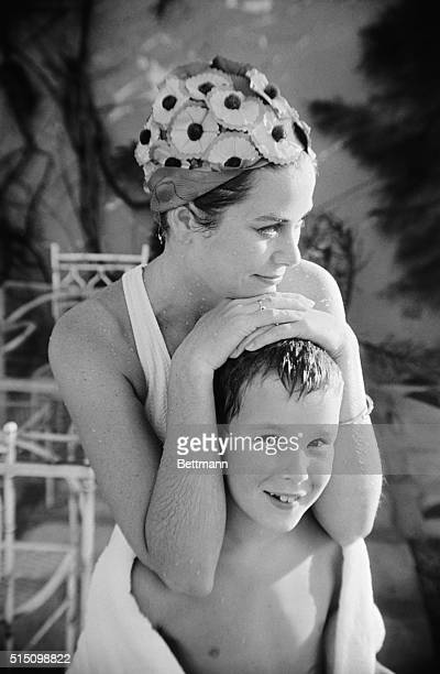 On Vacation. Montego Bay, Jamaica: Princess Grace of Monaco is the picture of contentment as she relaxes at a poolside with her nine-year old son...