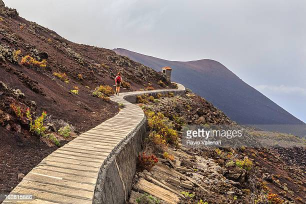 on volcanic footpath, la palma - volcano stock pictures, royalty-free photos & images