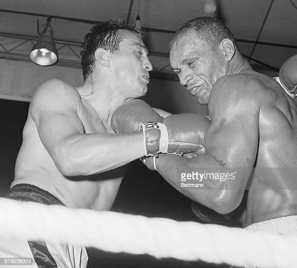On Way to Keeping His Title Berlin Light Heavyweight champion Harold Johnson of Philadelphia lands a left tot he jaw of German challenger Gustav...