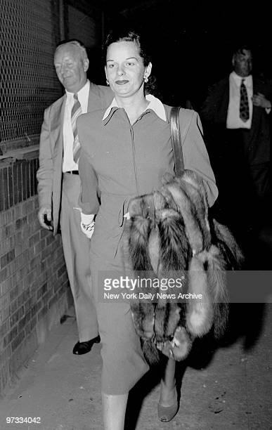 On way to Miami Virginia Hill girl friend of the slain gambler Bugsy Siegel walks from plane at Laguardia Field last night