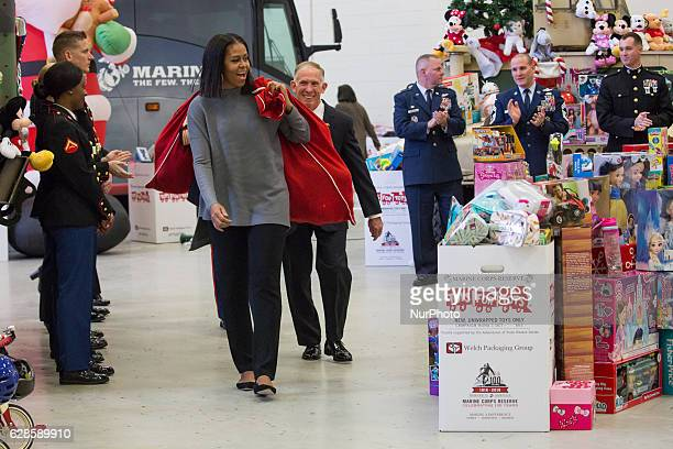 On Wednesday Dec 7 at Joint Base AnacostiaBolling First Lady Michelle Obama followed by Lieutenant General HP Osman United States Marine Corps Deputy...