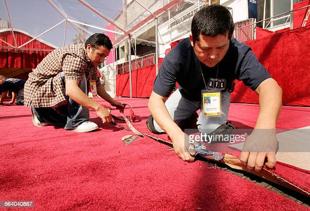 HOLLYWOOD CA On Wednesday Hugo Escobar working for ATC american turf and event flooring right and an unidentified workman left lay the red carpet...