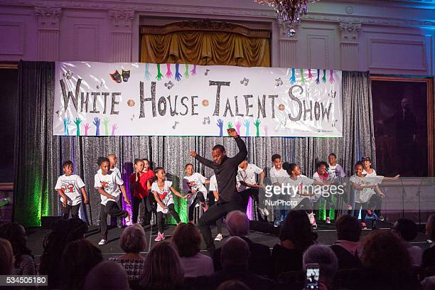 On Wednesday May 25 in the East Room of the White House dancer and Turnaround Mentor Charles quotLil Buckquot Riley performed with students from...