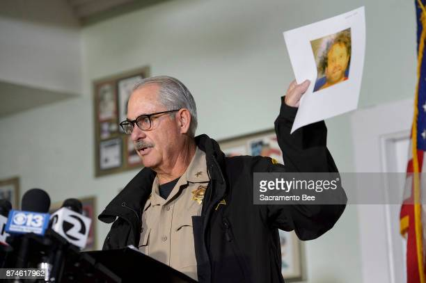On Wednesday Nov 15 Tehama County Assistant Sheriff Phil Johnston displays a recent booking photo of the suspected gunman Kevin Neal from yesterday's...
