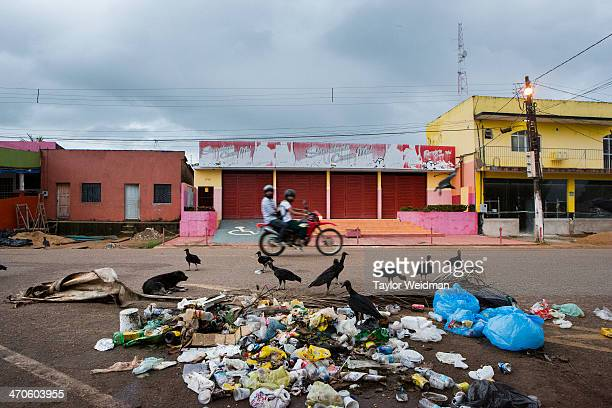 On weekends many of the dam workers drink at Altamira's riverside leaving trash that feeds the town's vultures and stray dogs The Amazonian city of...