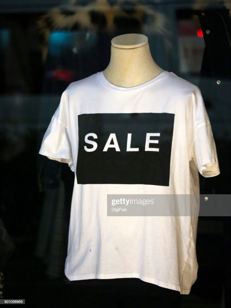 'SALE' on white shirt : Stock Photo
