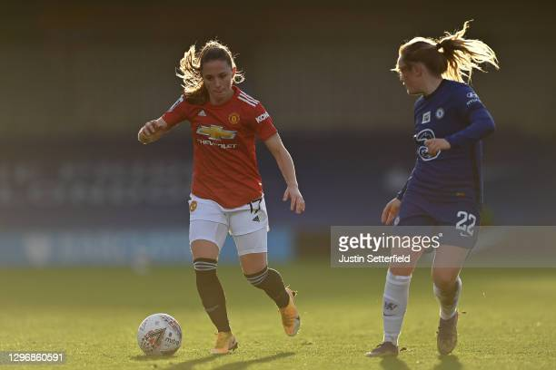 Ona Battle of Manchester United runs with the ball whilst being closed down by Erin Cuthbert of Chelsea during the Barclays FA Women's Super League...
