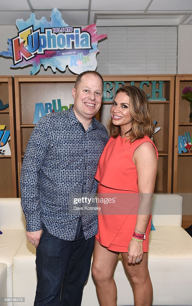 On-Air Personality Paul Cubby Bryant and Carolina Bermudez pose for a photo backstage during 103.5 KTU's KTUphoria 2016 presented by Aruba, at Nikon at Jones Beach Theater on June 4, 2016 in Wantagh, NY. (Photo by Dave Kotinsky/Getty Images for iHeart Media))