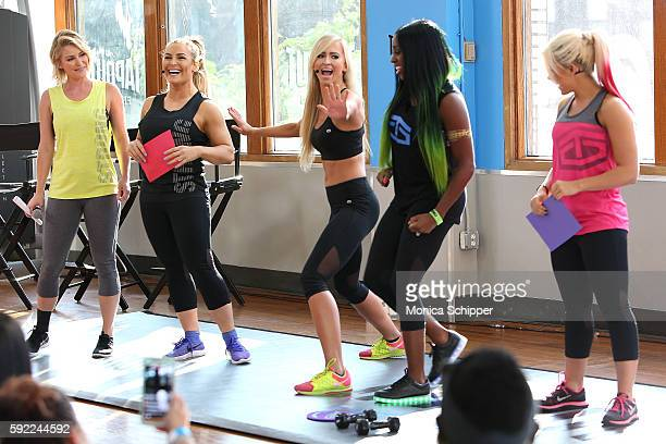 WWE onair personality Renee Young professional wrestlers Natalya Neidhart Summer Rae Naomi and Alexa Bliss participate in the Tapout Fitness WWE...