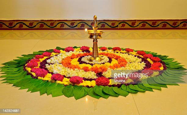 onam celebrations at home - rangoli stock pictures, royalty-free photos & images