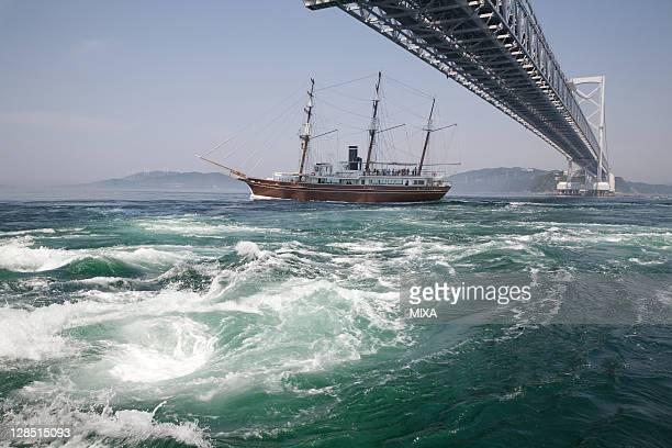 onaruto whirlpool and boat, naruto, tokushima, japan - naruto stock photos and pictures