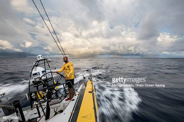 Onboard Abu Dhabi Ocean Racing Ian Walker at the helm of Azzam chased by a line of giant squalls trying to pull him back into the Doldrums during Leg...