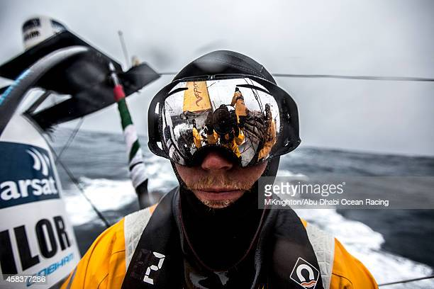 Onboard Abu Dhabi Ocean Racing Luke Parkinson with his goggles on reflecting the camera and watch team working on the boat on day 23 of Leg 1 between...