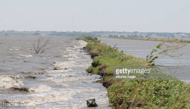 Once 50 feet wide this dike between a pool and the inlet canal has been breached by erosion in six places at the Cheyenne Bottoms Wildlife Area in...