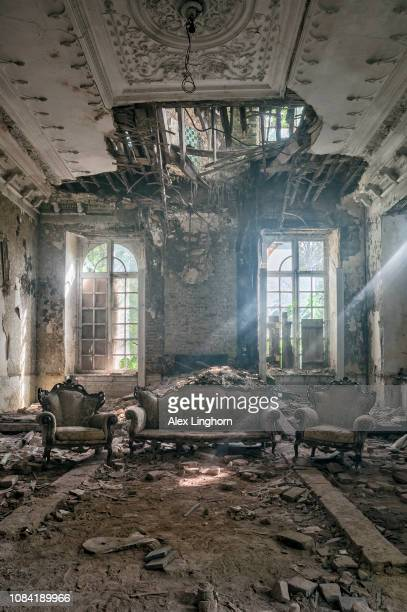 once opulent living room of an abandoned house - house collapsing stock pictures, royalty-free photos & images