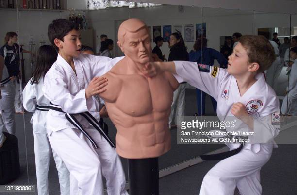 Once or twice a year Tae Kwon Do master Roger Carlon administers a test for top students to obtain their black belt. Students training for their...