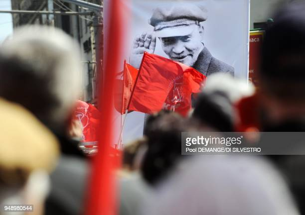 Once there Valery and Nina melt into the sea of red flags being waved by the winds of patriotic songs and harangues of representatives of the...
