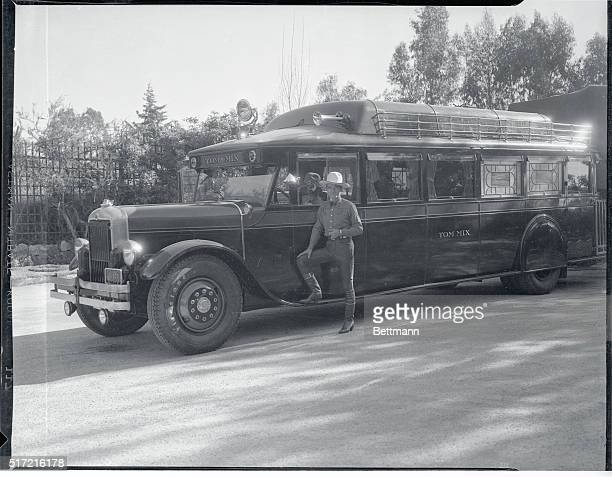 Once Tom Mix rode cattle trails with gun and blanket Now he travels in this rolling palace to lucrative motion picture jobs This palatial bus...