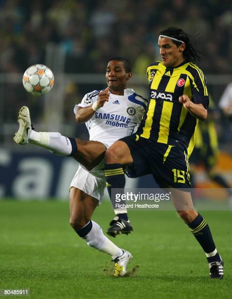 Onder Turaci of Fenerbahce and Florent Malouda of Chelsea battle for the ball during the UEFA Champions League Quarter Final 1st Leg match between...
