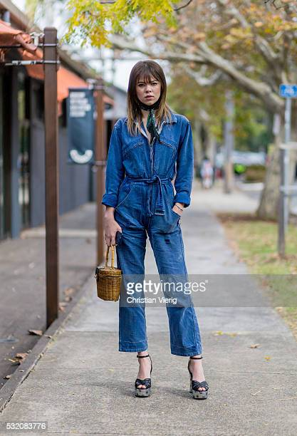 Ondine PurintonMiller wearing a navy denim jumpsuiit outside C Meo Collective at MercedesBenz Fashion Week Resort 17 Collections at Carriageworks on...