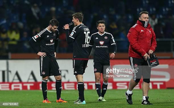 Ondrej Celustka Niclas Stark and Alessandro Schoepf of Nuernberg look dejected after the 2 Bundesliga match between Eintracht Braunschweig and 1 FC...