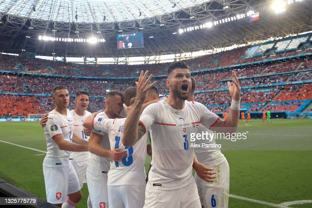 Ondrej Celustka of Czech Republic celebrates their side's first goal scored by team mate Tomas Holes during the UEFA Euro 2020 Championship Round of...