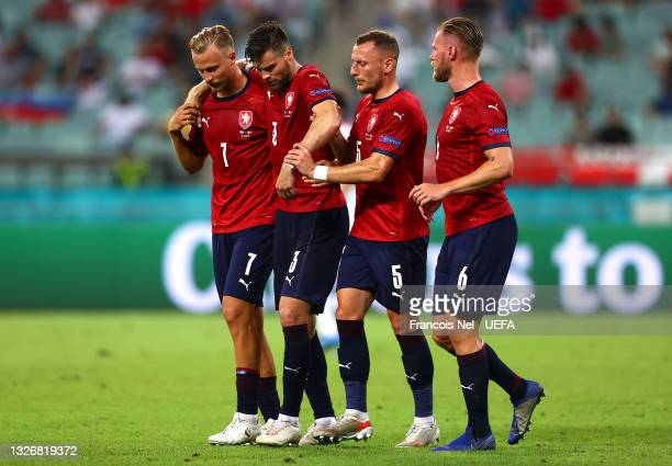 Ondrej Celustka of Czech Republic is helped by team mates Antonin Barak, Vladimir Coufal and Tomas Kalas after an injury during the UEFA Euro 2020...